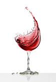 Red wine glass on a white background Stock Image