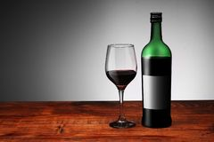 Red wine with a glass royalty free stock photography