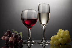 Red wine glass and white wine glass with vine Royalty Free Stock Image