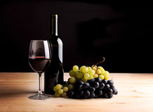 Red Wine glass, wine bottle and grapes Stock Photos