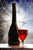 Red wine with glass on winter background Royalty Free Stock Photo