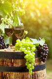 Red wine and glass on wodden barrel. Royalty Free Stock Photography