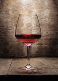Red wine glass on wooden background Stock Photography