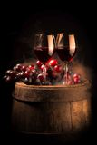 Red wine glass on wooden barrel. Isolated on black gradient royalty free stock photos