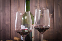 Red wine glasses, bottle and corks Royalty Free Stock Photography