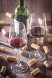 Red wine glasses, bottle and corks Royalty Free Stock Images