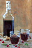 Red wine. Glasses and Bottle on a wooden background Stock Photography