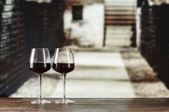 Wine in the wine cellar. Red wine in glasses in the cellar, wine tasting, French winery royalty free stock photo
