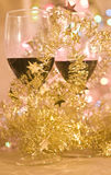 Red wine in glasses and Christmas decoration Royalty Free Stock Images