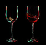 Red wine glasses with cork over black background. Stock Photo