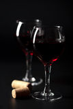 Red wine in glasses and corks Stock Photo