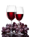 Red wine in glasses with grape isolated Royalty Free Stock Photo