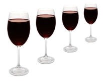 Red wine glasses in a row. Four red wine glasses in a row isolated on white Stock Photography