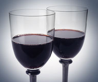 Red wine glasses two. Wine glasses on grey background Stock Images