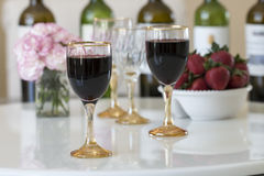 Red wine in a glasses on white table background. Royalty Free Stock Photo