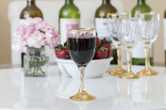 Red wine in a glasses on white table background. Royalty Free Stock Image