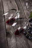 Red wine in glasses on a wooden background. Red wine in glasses on a dark wooden background Stock Images