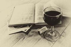 Red wine glasson wooden table. vintage filtered image. black and white style photo Royalty Free Stock Photo