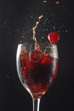 Red Wine Grape. Red wine glass splash grape Stock Image