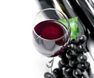 Red wine and grape. Isolated, white background Royalty Free Stock Photography