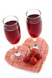 Red wine and grape on a background of heart Royalty Free Stock Photos
