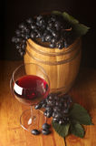 Red wine, grape and barrel Royalty Free Stock Photo