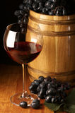 Red wine, grape and barrel Stock Image