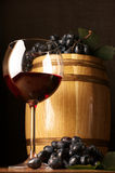 Red wine, grape and barrel Royalty Free Stock Image