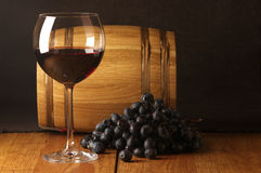 Red wine, grape and barrel Stock Photos
