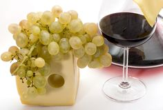 Red wine,grape and cheese. Glass of wine,decanter,grape and slice of cheese on a white background. Studio Royalty Free Stock Photo