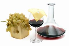 Red wine,grape and cheese. Glass of wine,decanter, grape and slice of cheese on a white background. Studio Royalty Free Stock Images