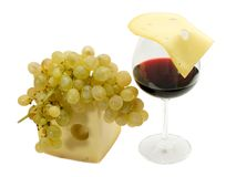 Red wine,grape and cheese. Glass of wine, grape and slice of cheese on a white background. Studio Royalty Free Stock Photography