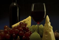 Red wine, grape, cheese I. A glass of red wine, some grape and cheese Stock Photos