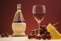 Red wine, grape, cheese III. A glass of red wine, some grape and cheese Stock Photo