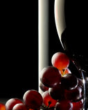 Red wine with grapes Stock Images