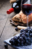Red wine and grapes. In vintage setting royalty free stock image
