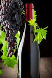 Wine grapes and wine on a wooden background stock images