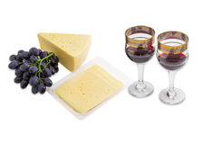 Red wine, grapes and cheese on a light background Royalty Free Stock Photos