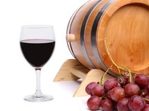 Red wine, grapes and old barrel Royalty Free Stock Photo