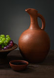 Red wine with grapes and a pitcher Royalty Free Stock Image