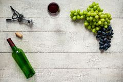 Red Wine with Grapes on White Background royalty free stock photography