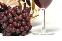 Red wine and grapes on white background Stock Photos