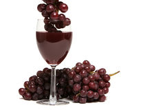 Red wine and grapes on white background Royalty Free Stock Image