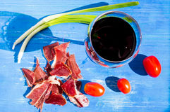 Red wine and ham with tomatoes. Royalty Free Stock Photos