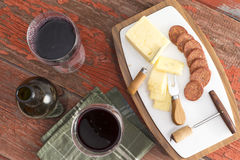 Red wine with harvati cheese and spicy sausage Royalty Free Stock Photo