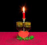 Red wine, heart made of red paper and burning candle Royalty Free Stock Photos
