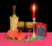 Red wine, heart made of red paper, candle, paper bags Royalty Free Stock Images
