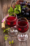 Red Wine In Glasses With Grapes Royalty Free Stock Image
