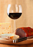 Red wine with italian cheese and capocollo Royalty Free Stock Photo