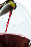 The red wine jet. With glass and bottle close up royalty free stock photo